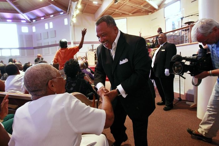 The Rev. Fred Luter Jr., pastor of the Franklin Avenue Baptist Church in New Orleans, greets the congregation during services on Sunday, June 3, 2012. (AP Photo/Gerald Herbert)