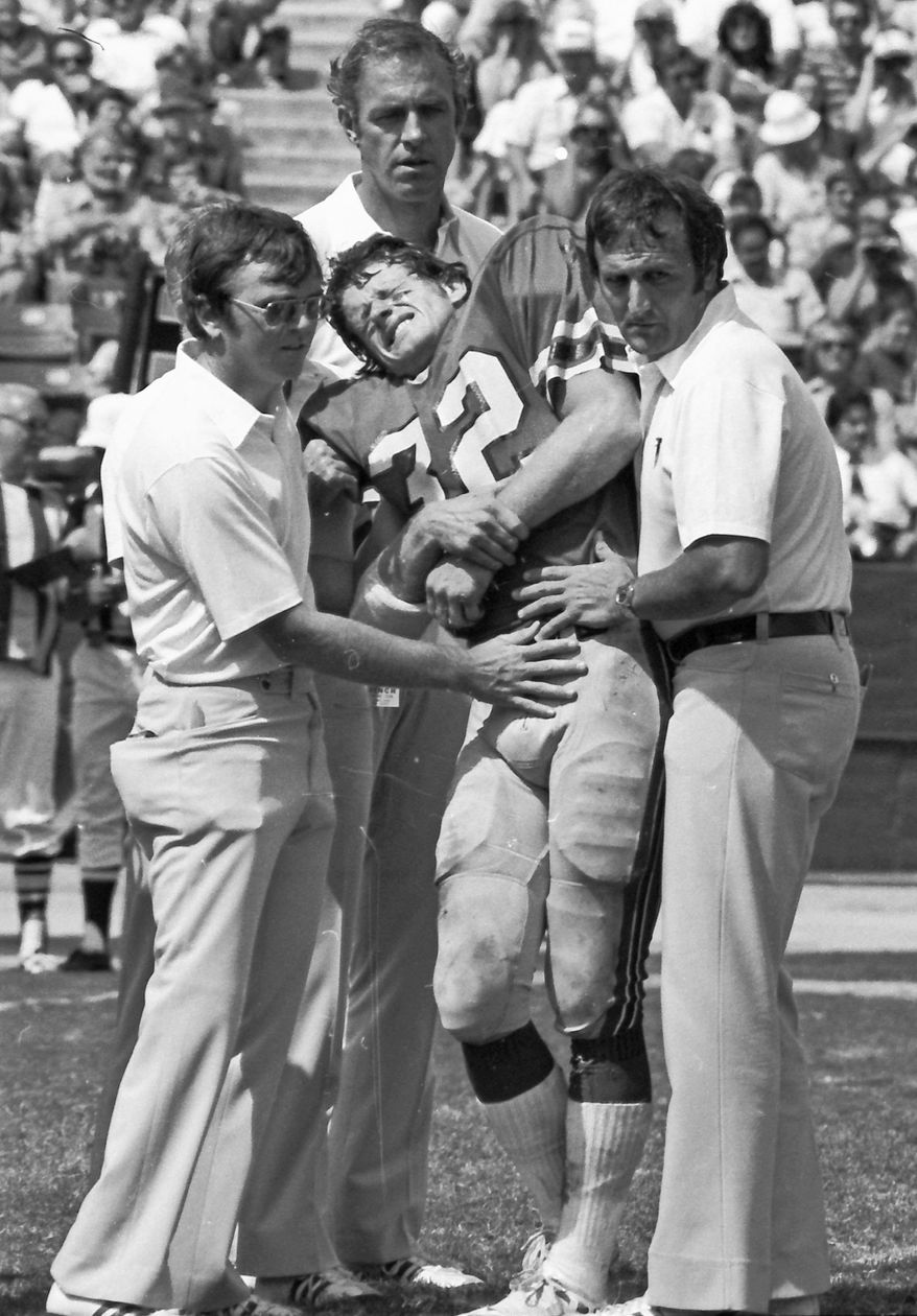 Ray Easterling, shown being helped from the field during an Atlanta Falcons game in 1978, shot himself in his Richmond home in April. He was 62. (Associated Press)
