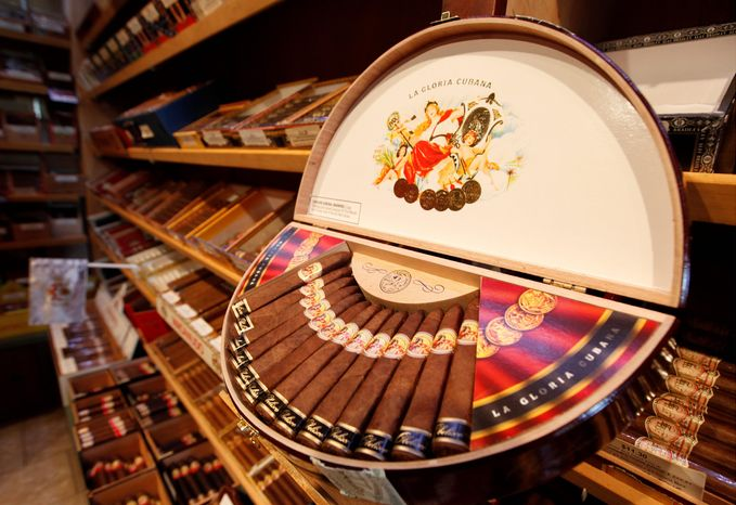 The shelves at Havana Connections cigar shop in Richmond show the many varieties of premium cigars, which aficionados liken to fine wine or craft beer. They say the range of cigar sizes and shapes makes across-the-board standards almost impossible. (Associated Press)