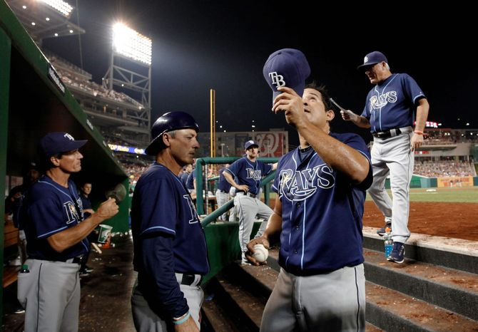 Tampa Bay reliever Joel Peralta, a former National, tips his cap to fans at Nationals Park after he was ejected from Tuesday's game for having pine tar on his glove. The incident sparked a war of words between the teams' managers. (Associated Press)