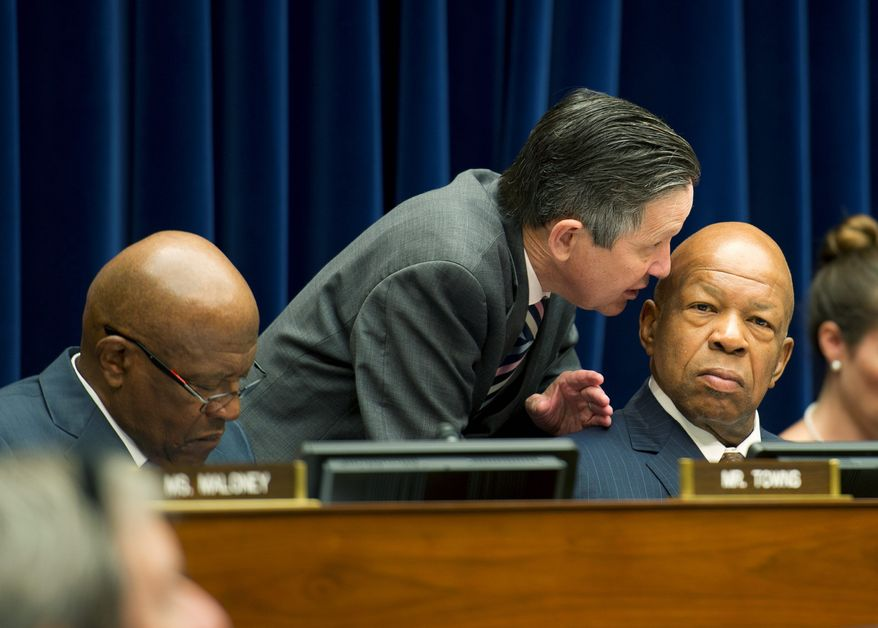 "Rep. Dennis J. Kucinich, Ohio Democrat, whispers to Rep. Elijah E. Cummings, Maryland Democrat, during a Committee on Oversight and Government Reform hearing. The panel voted to recommend that Attorney General Eric H. Holder Jr. be held in contempt of Congress in the ""Fast and Furious"" gun-walking case. (Barbara L. Salisbury/The Washington Times)"