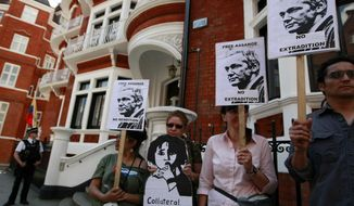 Supporters of WikiLeaks founder Julian Assange demonstrate on Wednesday, June 20, 2012, outside the Ecuadorean Embassy in London, where Mr. Assange is seeking asylum. (AP Photo/Tim Hales)