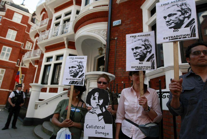 Supporters of WikiLeaks founder Julian Assange demonstrate on Wednesday, June 20, 2012, outside the Ecuadorean Embassy in London, where Mr. Assange is seeking asylum. (AP Photo/Tim Hales)
