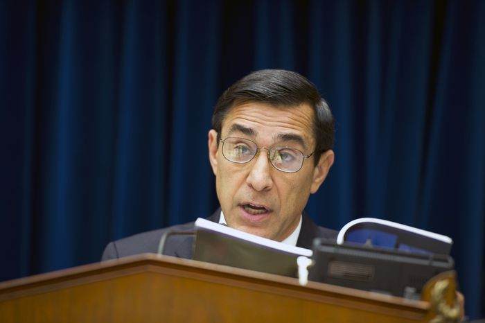 """** FILE ** Rep. Darrell E. Issa, California Republican and chairman of the House Committee on Oversight and Government Reform, reads from a book on June 20, 2012, at the Rayburn House Office Building on Capitol Hill, quoting the president's right to assert executive privilege after learning that President Obama has done so in the """"Fast and Furious"""" gun-tracking case, refusing to turn over related documents to Congress. The committee proceeded with its markup to vote on whether to hold Attorney General Eric H. Holder Jr. in contempt for his failure to produce those documents. (Barbara L. Salisbury/The Washington Times)"""