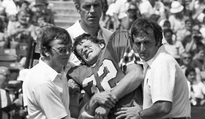 ASSOCIATED PRESS Ray Easterling, shown being helped from the field during an Atlanta Falcons game in 1978, shot himself in his Richmond home in April. He was 62.