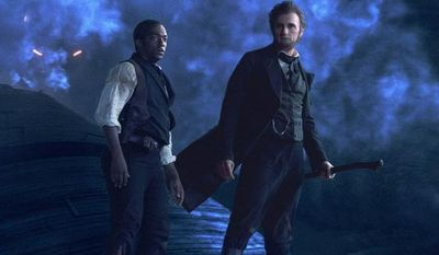 "Benjamin Walker stars as the ax-wielding title character in ""Abraham Lincoln: Vampire Hunter"" while Anthony Mackie plays Lincoln's sidekick, William H. Johnson. (20th Century Fox via Associated Press)"