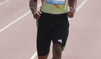 Tyson Gay crosses the finish line ahead of the pack during the 100-meter B race at the Adidas Grand Prix track and field meet on Randall's Island, Saturday, June 9, 2012, in New York. (AP Photo/Mary Altaffer)