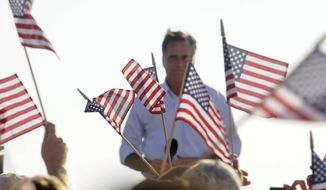 Republican presidential candidate Mitt Romney speaks to supporters at the Holland State Park beach in Michigan on Tuesday, June 19, 2012. (AP Photo/Grand Rapids Press, Chris Clark )