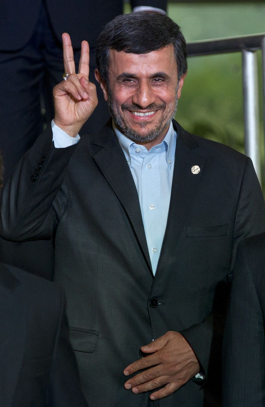 Iran President Mahmoud Ahmadinejad poses June 20, 2012, for a photo at the United Nations conference on sustainable development, or Rio+20, in Rio de Janeiro. (Associated Press)