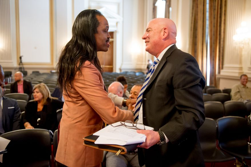 Verdine White of the band Earth, Wind, and Fire, left, speaks to Thomas P. McDevitt, President of the Washington Times Newspaper, right, the Master of Ceremonies for the Congressional Award Gold Medal awards ceremony in the Cannon House Office Building on Capitol Hill, Washington, D.C., Wednesday, June 20, 2012. The 276 youth honored this year in the annual award ceremony for completing 400 hours of Voluntary Public Service activities, 200 hours each of Personal Development and Physical Fitness activities, as well as an Expedition and Exploration activity were greeted by members of congress as well as Verdine White and Ralph Johnson, two members of Earth, Wind, and Fire. (Andrew Harnik/The Washington Times)