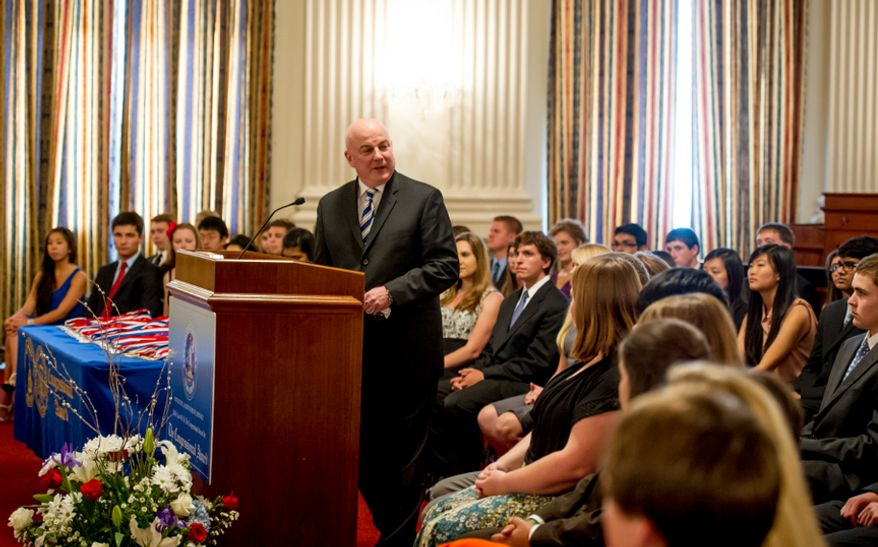 Thomas P. McDevitt, President of the Washington Times Newspaper acts as the Master of Ceremonies as youth are awarded the Congressional Award Gold Medal during an award ceremony in the Cannon House Office Building on Capitol Hill, Washington, D.C., Wednesday, June 20, 2012. The 276 youth honored this year in the annual award ceremony for completing 400 hours of Voluntary Public Service activities, 200 hours each of Personal Development and Physical Fitness activities, as well as an Expedition and Exploration activity were greeted by members of congress as well as Verdine White and Ralph Johnson, two members of Earth, Wind, and Fire. (Andrew Harnik/The Washington Times)