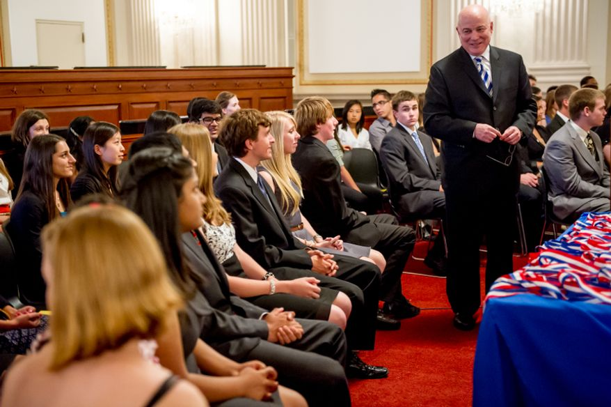 Thomas P. McDevitt, President of the Washington Times Newspaper, second from right, acts as the Master of Ceremonies as youth are awarded the Congressional Award Gold Medal during an award ceremony in the Cannon House Office Building on Capitol Hill, Washington, D.C., Wednesday, June 20, 2012. The 276 youth honored this year in the annual award ceremony for completing 400 hours of Voluntary Public Service activities, 200 hours each of Personal Development and Physical Fitness activities, as well as an Expedition and Exploration activity were greeted by members of congress as well as Verdine White and Ralph Johnson, two members of Earth, Wind, and Fire. (Andrew Harnik/The Washington Times)