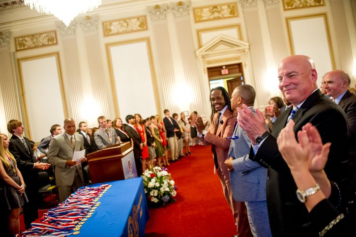 Thomas P. McDevitt, President of the Washington Times Newspaper, right, acts as the Master of Ceremonies as youth are awarded the Congressional Award Gold Medal during an award ceremony in the Cannon House Office Building on Capitol Hill, Washington, D.C., Wednesday, June 20, 2012. The 276 youth honored this year in the annual award ceremony for completing 400 hours of Voluntary Public Service activities, 200 hours each of Personal Development and Physical Fitness activities, as well as an Expedition and Exploration activity were greeted by members of congress as well as Verdine White and Ralph Johnson, two members of Earth, Wind, and Fire. (Andrew Harnik/The Washington Times)
