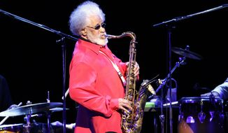 ** FILE ** Jazz saxophonist Sonny Rollins performs during a concert in Tokyo in October 2010. (AP Photo/Junji Kurokawa, File)