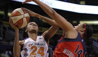 Phoenix Mercury's DeWanna Bonner (24) gets fouled by Washington Mystics' Lindsay Wisdom-Hylton (14) during the third quarter Wednesday, June 20, 2012, in Phoenix. The Mercury defeated the Mystics 79-77.(AP Photo/Ross D. Franklin)