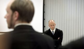 Anders Behring Breivik (left), the confessed gunman who killed 77 people last year in a bomb-and-shooting rampage, and prosecutor Svein Holden are pictured during closing arguments in Mr. Breivik's trial in Oslo on Thursday, June 21, 2012. (AP Photo/Berit Roald, Scanpix, Pool)
