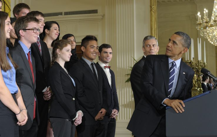 **FILE** President Obama, with Education Secretary Arne Duncan (second from right) at his side, looks back June 21, 2012, at a group of students during a news conference at the White House as he calls on Congress to stop interest rates on student loans from doubling. (Associated Press)