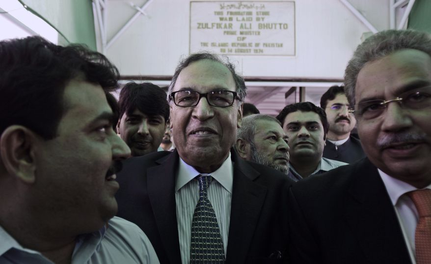 Makhdoom Shahabuddin (center), nominated as prime minister by the ruling Pakistan People's Party, leaves Parliament in Islamabad, Pakistan, on Thursday, June 21, 2012, after filing his candidacy papers. (AP Photo/Muhammed Muheisen)