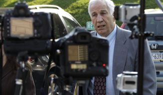 Former Penn State University assistant football coach Jerry Sandusky arrives June 21, 2012, at the Centre County Courthouse in Bellefonte, Pa. Sandusky is charged with 51 counts of child sexual abuse involving 10 boys over a period of 15 years. (Associated Press)