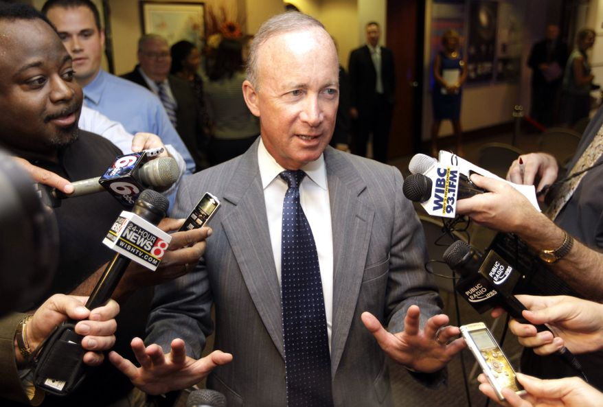 Indiana Gov. Mitch Daniels declines to answer questions on reports that he will be named president of Purdue University following an economic development announcement in Indianapolis, Wednesday, June 20, 2012. Daniels was introduced Thursday as the next president of Purdue University, quashing speculation that he would be tapped as a vice presidential candidate or a Cabinet appointee should Mitt Romney win the White House in November. (AP Photo/Michael Conroy)