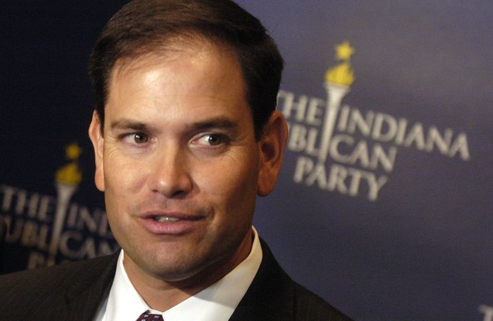 **FILE** Florida Sen. Marco Rubio answers a question June 4, 2012, during a brief press conference following a roundtable luncheon hosted by the Indiana Republican party in Merrillville, Ind. (Associated Press/The Post-Tribune)