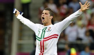 Portugal's Cristiano Ronaldo celebrates winning the Euro 2012 quarterfinal match between Czech Republic and Portugal in Warsaw, Poland, on Thursday, June 21, 2012. (AP Photo/Antonio Calanni)