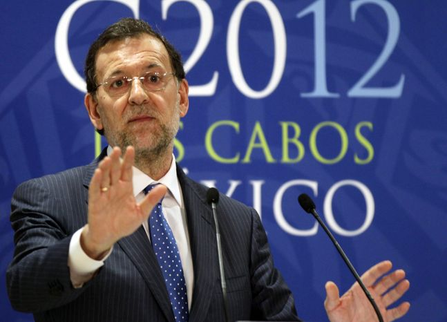 **FILE** Spain's Prime Minister Mariano Rajoy speaks June 19, 2012, to the press during the G-20 summit in Los Cabos, Mexico. (Associated Press)