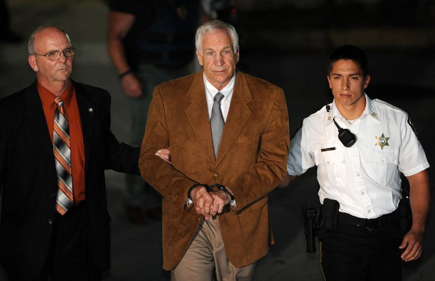 Jerry Sandusky leaves the Centre County Courthouse in Bellefonte, Pa., on Friday, June 22, 2012, after being found guilty in his sexual abuse trial. (AP Photo/Centre Daily Times, Nabil K. Mark)
