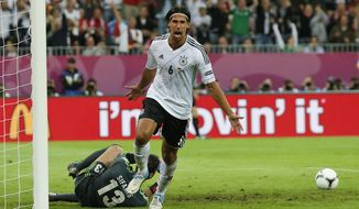 Germany's Sami Khedira celebrates after he scored his team's second goal during the Euro 2012 quarterfinal match between against Greece in Gdansk, Poland, on Friday, June 22, 2012. Germany won 4-2 on the heels of three second-half markers. (AP Photo/Jon Super)
