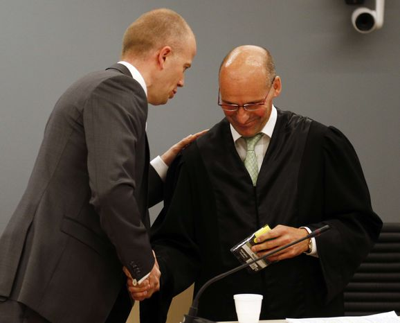 Prosecutor Svein Holden, left, talks to defense lawyer Geir Lipepstad in court during the trial of terror charged Anders Behring Breivik in Oslo, Friday, June 22, 2012. (AP Photo/Lise Aserud/pool)