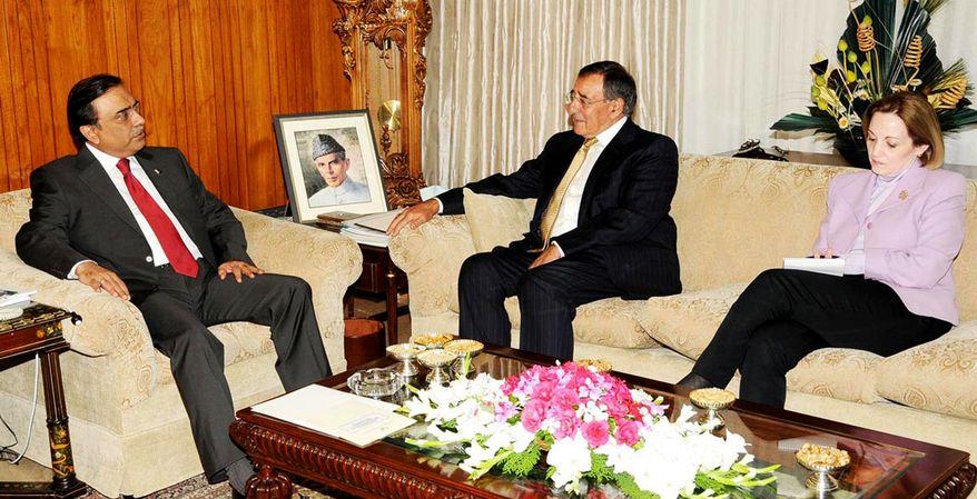 **FILE** Pakistani President Asif Ali Zardari (left) meets Sept. 30, 2010, with then-CIA Director Leon Panetta in Islamabad, Pakistan. Anne Patterson, U.S. ambassador to Pakistan, is seen on right. (Associated Press/Press Information Department)