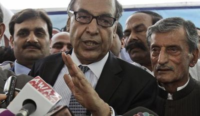 Makhdoom Shahabuddin (center), nominated prime minister by the ruling Pakistan People's party, speaks to reporters June 21, 2012, after filing his candidacy paper at the Parliament in Islamabad, Pakistan. (Associated Press)
