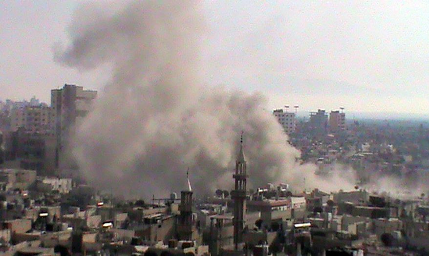 This citizen journalism image provided by Shaam News Network SNN and taken on Thursday, June 21, 2012, purports to show smoke from shelling rising up from buildings in the Khaldiyeh neighborhood of Homs province, central Syria. The Associated Press is unable to independently verify the authenticity, content, location or date of this handout photo. (AP Photo/Shaam News Network, SNN)