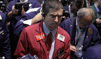 Trader Stephen Guilfoyle (center) works June 22, 2012, on the floor of the New York Stock Exchange. (Associated Press)