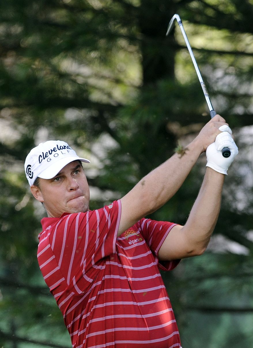 Roland Thatcher watches his tee shot on the eighth hole during the third round of the Travelers Championship golf tournament in Cromwell, Conn., Saturday, June 23, 2012. Thatcher finished his round of 65 tied for the tournament lead at 12-under par. (AP Photo/Fred Beckham)