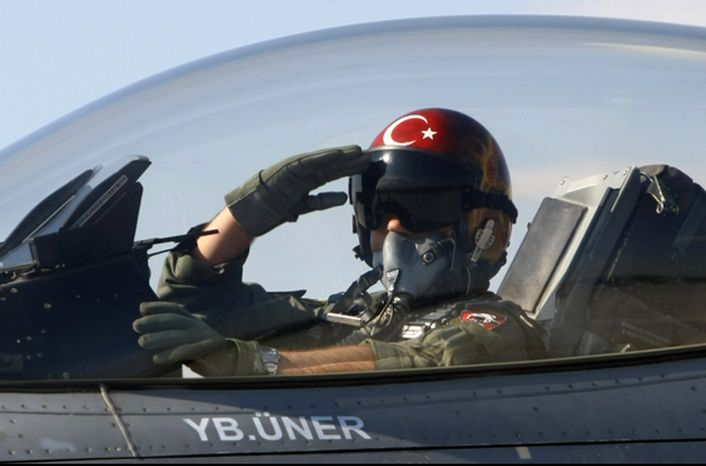 """** FILE ** In this April 29, 2010, file photo, a Turkish pilot salutes before take-off at an air base in Konya, Turkey. Turkish President Abdullah Gul said Saturday, June 23, 2012, his country would take """"necessary"""" action against Syria for the downing of a Turkish military jet, but suggested that the aircraft may have unintentionally violated the Syrian airspace. The plane went down in the Mediterranean Sea about 8 miles (13 kilometers) away from the Syrian town of Latakia, Turkey, said. (AP Photo/File)"""