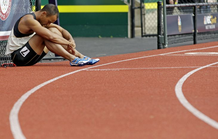 Bryan Clay reacts after the 110m hurdles during the decathlon competition at the U.S. Olympic Track and Field Trials on Saturday, June 23, 2012, in Eugene, Ore. (AP Photo/Morry Gash)