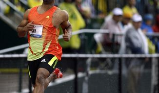Tyson Gay leads in a men's 100m preliminary at the U.S. Olympic Track and Field Trials Saturday, June 23, 2012, in Eugene, Ore.  (AP Photo/Marcio Jose Sanchez)