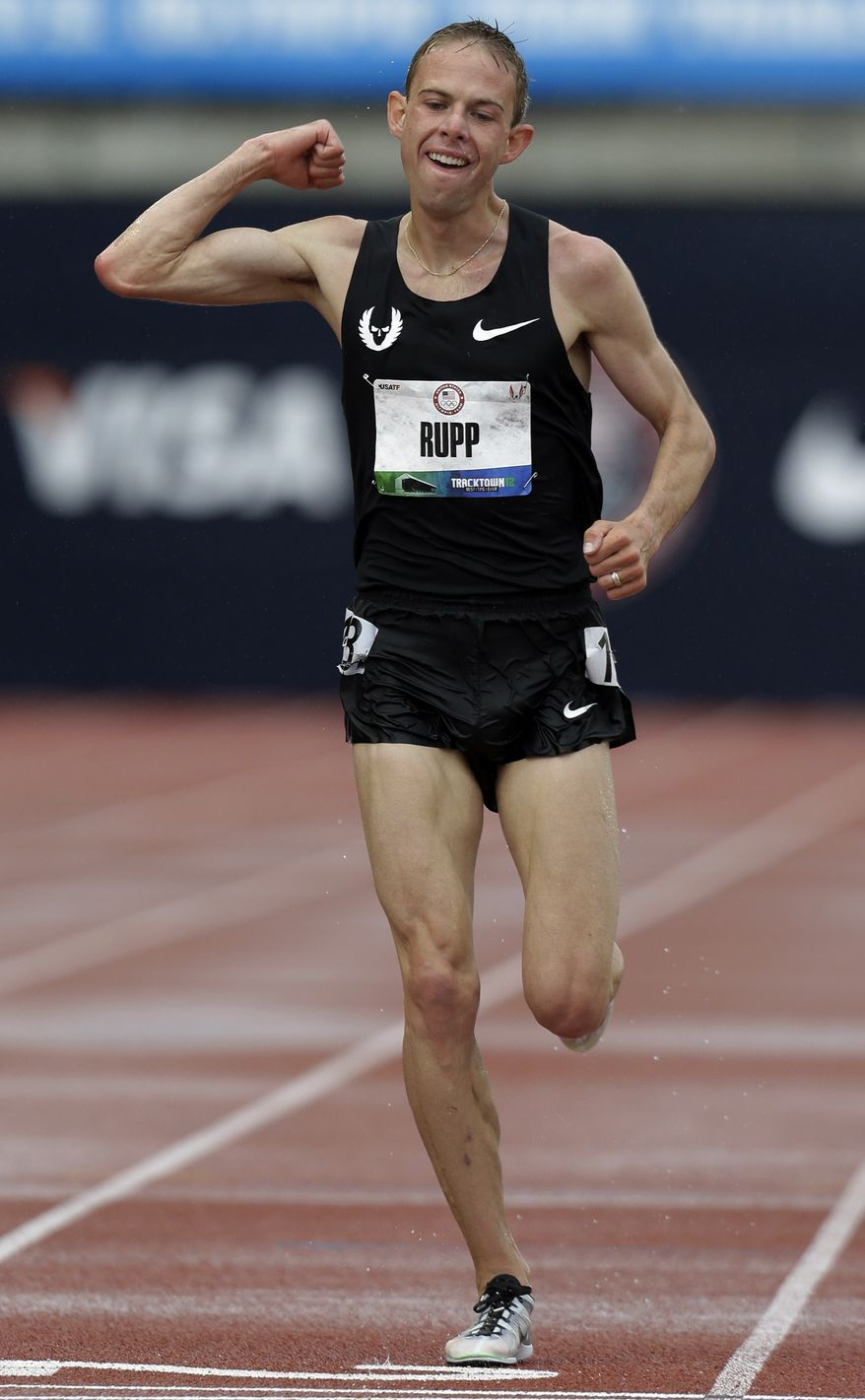 Galen Rupp reacts after finishing the men's 10,000m finals at the U.S. Olympic Track and Field Trials on Friday, June 22, 2012, in Eugene, Ore. Rupp finished first, Matt Tegenkapm second and Dathan Ritzenhein third. The three will represent the U.S. in the London Olympics. (AP Photo/Eric Gay)