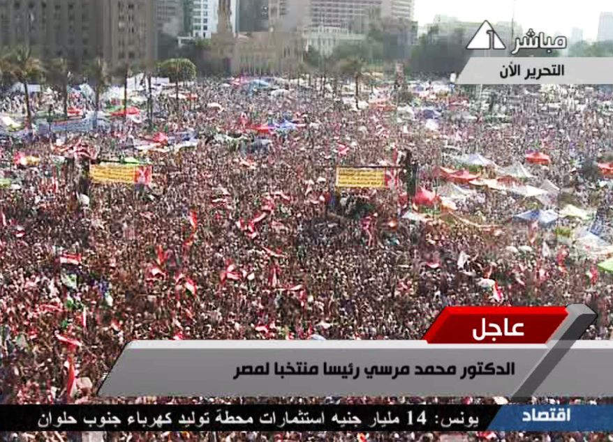 In this image taken from Egypt state TV, supporters of Muslim Brotherhood presidential candidate Mohammed Morsi celebrate his victory in Tahrir Square in Cairo on Sunday, June 24, 2012. (AP Photo/Egypt state TV)