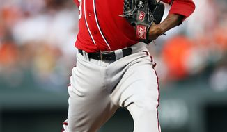 Washington Nationals starting pitcher Edwin Jackson throws to the Baltimore Orioles in the second inning of an interleague baseball game in Baltimore, Saturday, June 23, 2012. (AP Photo/Patrick Semansky)