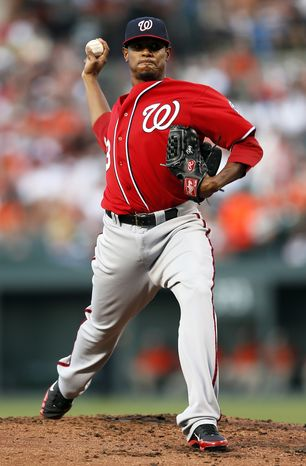 Washington Nationals starting pitcher Edwin Jackson throws to the Baltimore Orioles in the second inning ofan interleague baseball game in Baltimore, Saturday, June 23, 2012. (AP Photo/Patrick Semansky)
