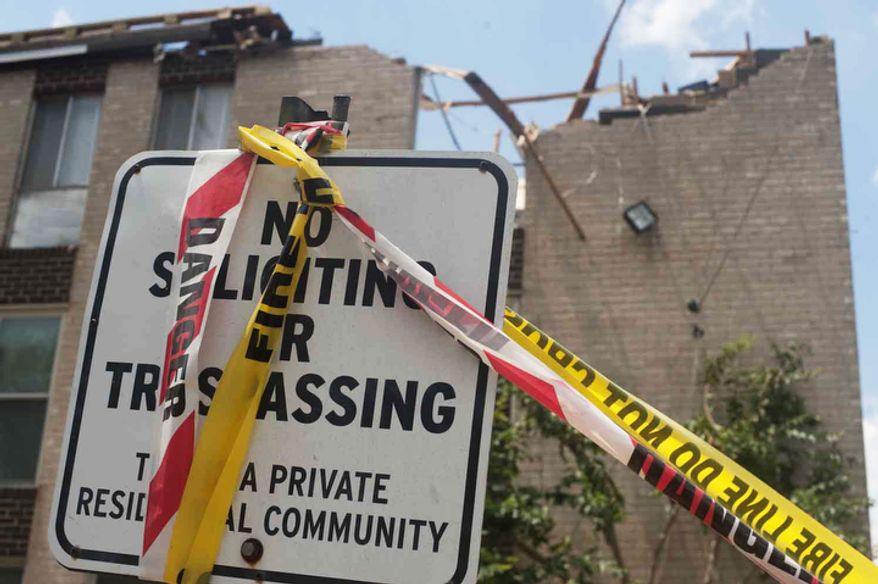 The roof of an apartment building near was destroyed on Sunday, June 24, 2012, in Bladensburg, Md. A mircoburst, a small concentrate downdraft, struck the area on Friday evening. (Raymond Thompson/The WashingtonTimes)