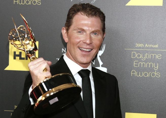 """Cooking show host Bobby Flay poses backstage with the Emmy for best culinary program for his """"Barbecue Addiction"""" at the 39th Annual Daytime Emmy Awards at the Beverly Hilton Hotel on Saturday, June 23, 2012, in Beverly Hills, Calif. (AP Photo/Todd Williamson, Invision)"""