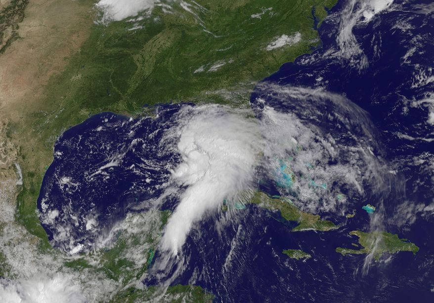 This NOAA satellite image taken on Saturday, June 23, 2012, shows shower and thunderstorm activity developing around an area of low pressure spinning in the Gulf of Mexico. (AP Photo/National Oceanic and Atmospheric Administration)