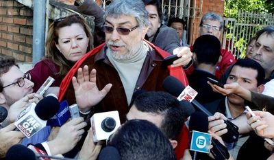 "Fernando Lugo, Paraguay's former president, talks to reporters outside his home in Lambare, on the outskirts of Asuncion, on Sunday, two days after Mr. Lugo was impeached and removed from office. He denounced the action as a ""parliamentary coup."" He exhorted his followers to remain peaceful as they hold protests. (Associated Press)"