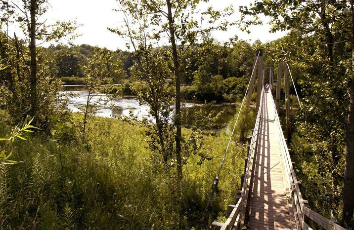 A suspension bridge over the Manistee River southeast of Mesick, Mich., is located on the North Country Scenic Trail. The North Country National Scenic Trail runs 4,600 miles from North Dakota to New York's eastern border. From there, it's about 40 miles across Vermont fields and mountains to the Appalachian Trail. Closing the 40-mile gap is a priority for the Michigan-based North Country Trail Association, the group responsible for the trail. (Associated Press)
