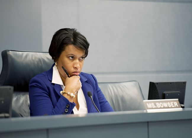 Councilmember Muriel Bowser, chair of the committee on government operations, listens to testimony during a public roundtable Monday, June 25, 2012 at the Wilson Building in Washington, D.C. on the nominees for the Board of Ethics and Accountability. The three nominees -- Robert Spagnoletti, Deborah Lanthen and Laura Richards -- all testified. (Barbara L. Salisbury/The Washington Times)