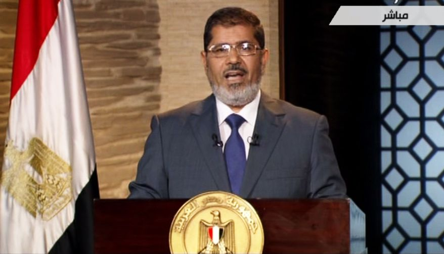 Egyptian President-elect Mohammed Morsi speaks in Cairo on Sunday, June 24, 2012, in this image taken from Egypt State TV. (AP Photo/Egypt State TV)