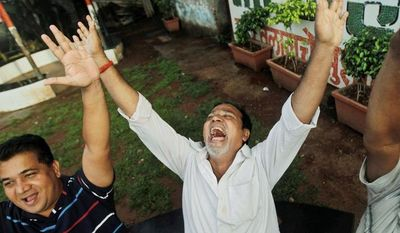 """Members of the Sheetal Jogging Association were gathering every morning around Sheetal Talao pond for laughter yoga, devotional singing and light exercise, but an Indian court told them to zip it after a neighborhood family complained about """"mental agony, pain and public nuisance."""" (Associated Press)"""
